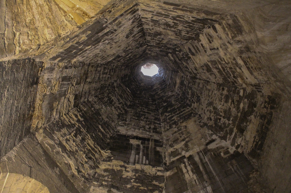 View looking up through the massive fireplace chimney in the kitchen.